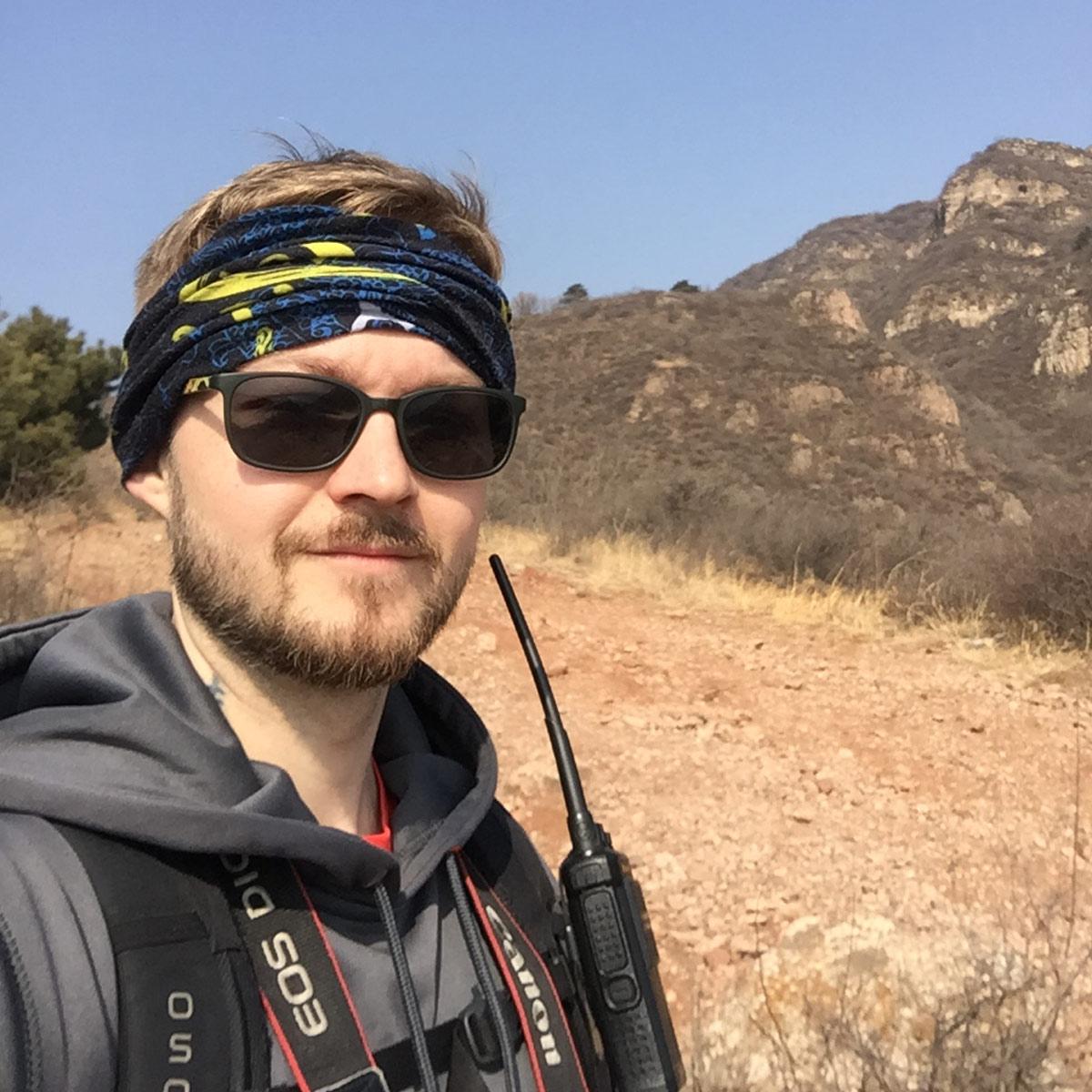 Trainer John Alsobrooks navigating during a hiking trip