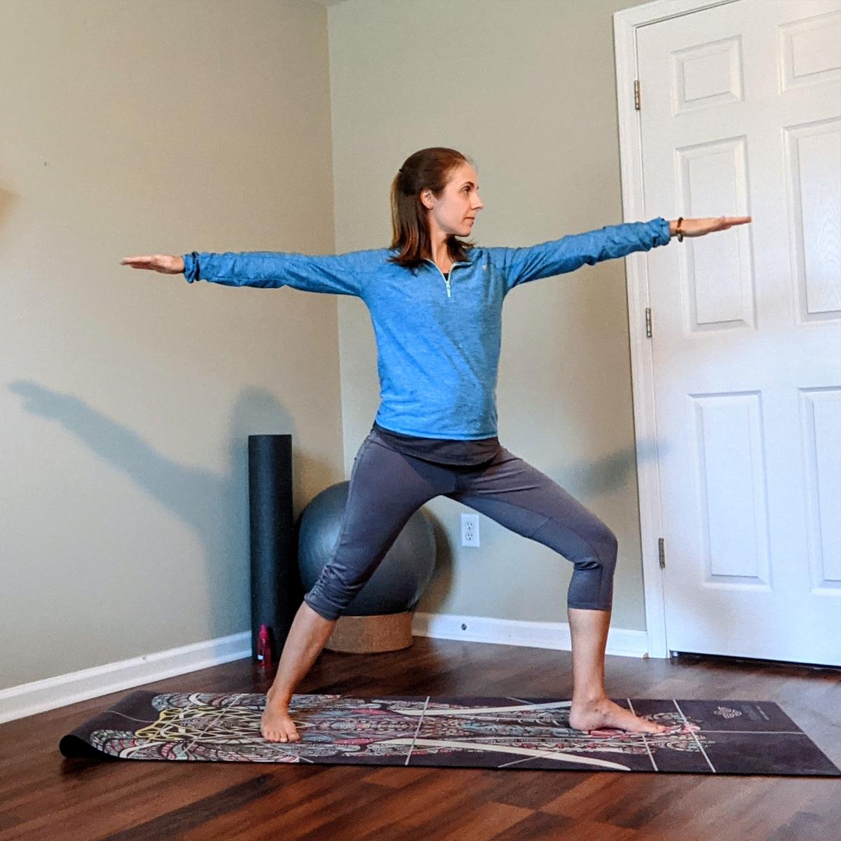 Skimble Trainer Casondra Leblanc teaching a Yoga Class in her home