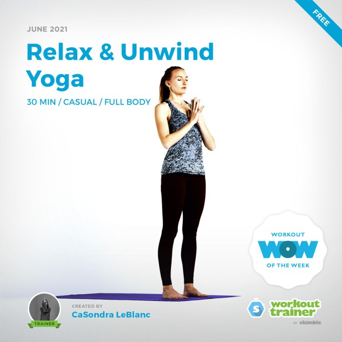 Female Yoga Instructor doing Mountain Pose with Prayer Hands at the top of her mat