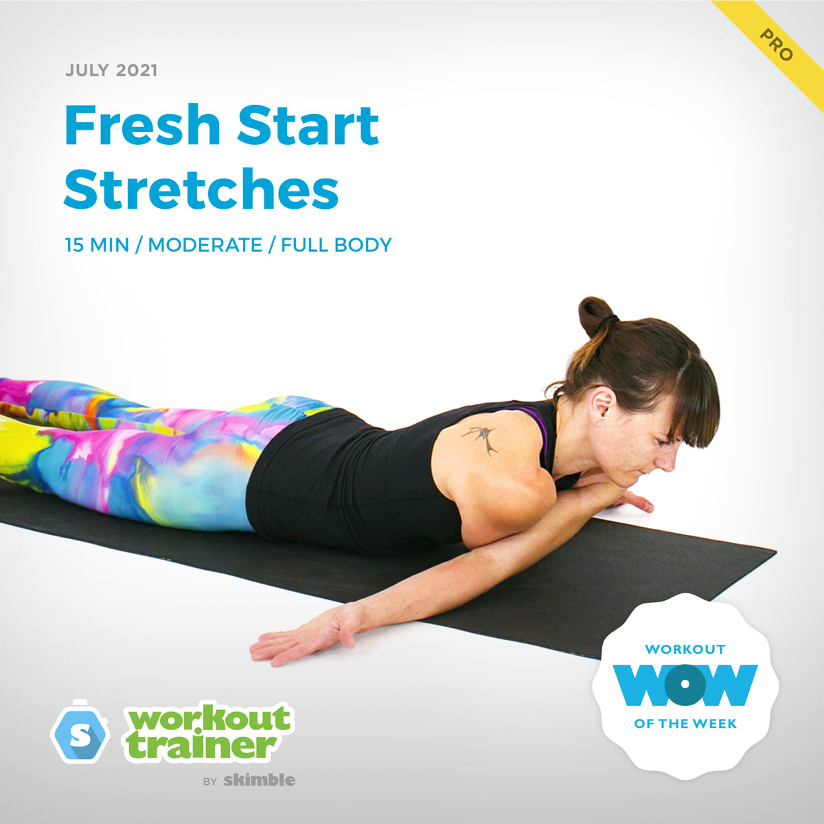 Female Yoga Instructor doing Downward Facing Deltoid Stretch on a yoga mat