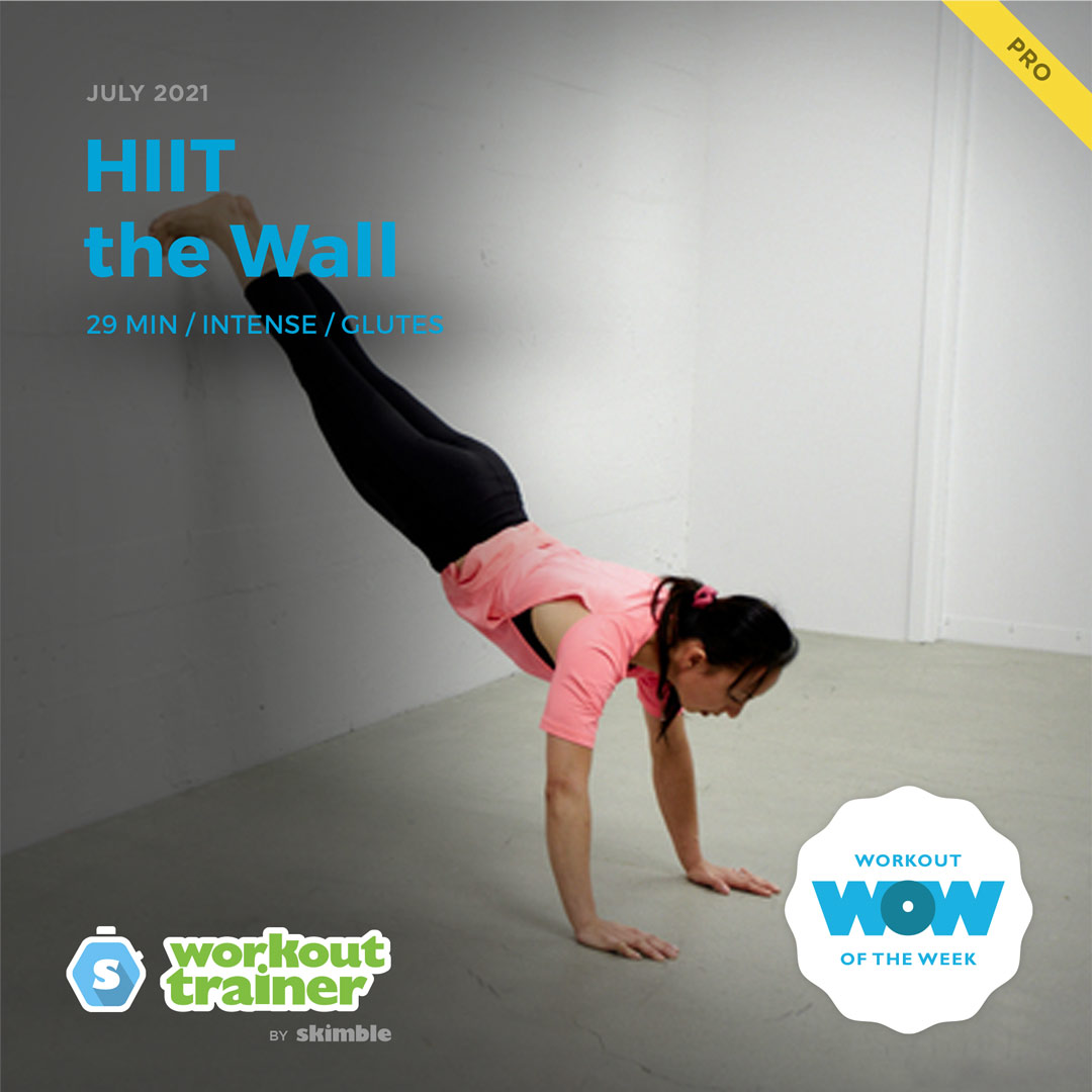 Female Fitness Expert holding a Wall Plank for 30 seconds