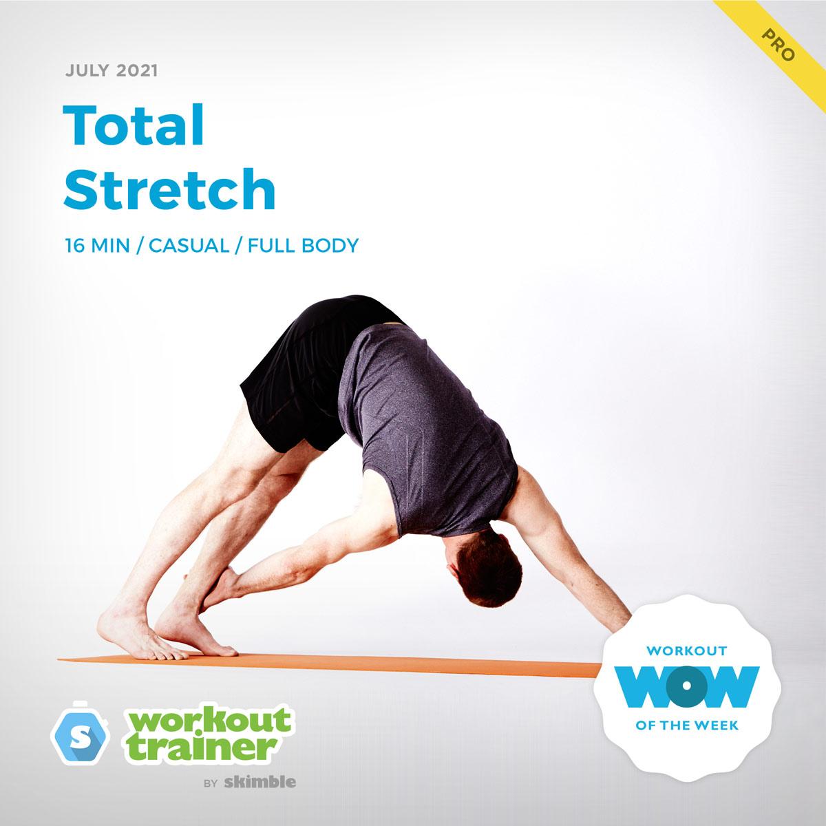Male Yoga Instructor doing Left Twisting Down Dog on a yoga mat