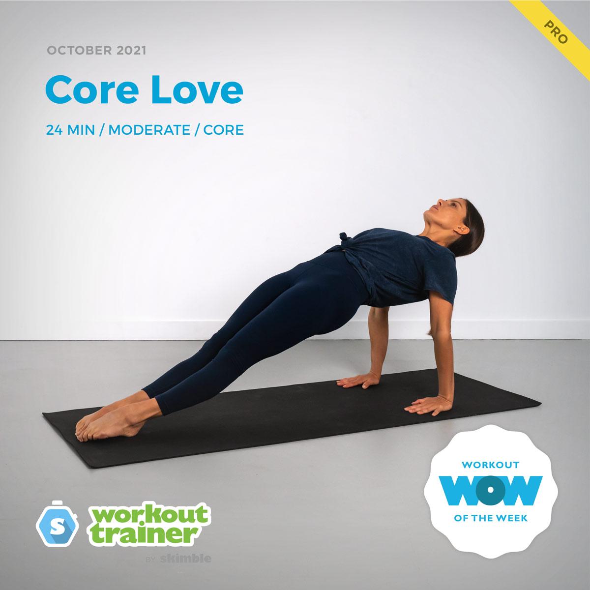 Female Yoga Instructor doing Upward Plank on a black yoga mat